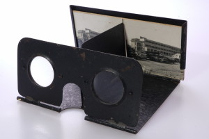 Antique folding stereo viewer and stereo view of Building